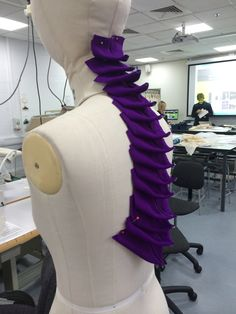 Own fabric manipulation samples on stand.