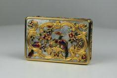 """A rare gold, enamel and mother-of-pearl snuff box by A. J. Strachan. The gold box cased with mother-of-pearl with gold and enamel cage work depicting flowers and birds. C1840. Dimensions: 2.6' x 1.6' x 0.7' <a href=""""http://www.imagehosting.me.uk/catalogue/lot109"""" target=""""_blank"""">PLEASE CLICK HERE TO VIEW 360° IMAGES</a>"""