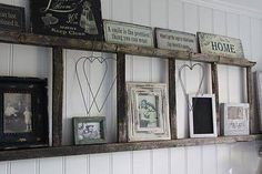 Great way to re-purpose an old wooden ladder, use it as a wall shelf for displaying pictures and cute knick knacks!