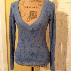Free People thermal top Blue with metallic butterfly detailing.  Great condition. Free People Tops Tees - Long Sleeve
