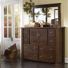 Dresser with Mirror from Wayfair Canada This dresser has a rustic look with a unique distressed finish.