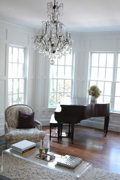 need to hang a chandelier over the piano in the music room...I've ALWAYS dreamed of having a baby baby grand piano....