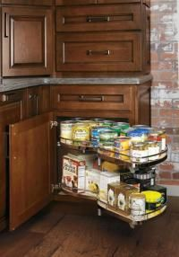 MasterBrand Cabinets' Diamond Cabinets with the Base Corner with Curved Pullout option provide a maximum-storage cabinet that swings out for easy accessibility. Chrome rails and a nonskid surface keep items in place while the shelves are in motion. Corner Cupboard, Corner Storage, Kitchen Corner, New Kitchen, Kitchen Ideas, Corner Pantry, Kitchen Redo, Kitchen Pantry, Kitchen Layout