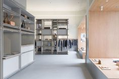 (Left) Cabinet lights (right) Surface downlights / A.P.C. Store by Laurent Deroo