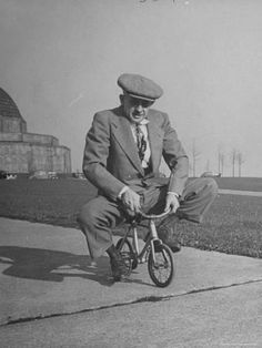Photographic Print: Humorous of Man Riding Tiny Bicycle by Wallace Kirkland : 24x18in