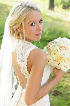 Bridal pose. Bridal photography. Blonde updo. Lace backless dress