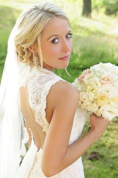 Bridal pose. Bridal photography. Blonde updo. Lace backless dress
