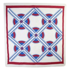 """The New York Beauty pattern is always popular and rarely seen. It is a difficult one to execute with the entire pattern consisting of curves and points. This striking example is nicely quilted with feather patterns in the white blocks. Measurements are 79"""" x 82""""."""
