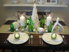 This may be the look I go for with my Christmas decorations this year - lots of white, frosted, green, and clear glass, with green accents.