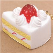 small piece of white cake with cream strawberry squishy cellphone charm Cafe de N