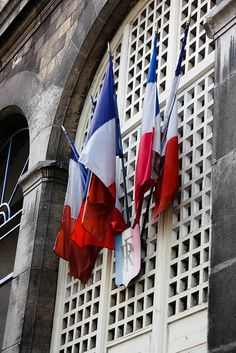 French flags in the Latin Quarter of Paris by TheLittleSwan, via Flickr