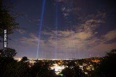 In preparation for the LA marathon, the city has placed spotlights at the mile markers at night.