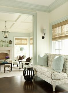 Using the wall color of an adjacent space as the trim color next door provides a subtle connection between the spaces.