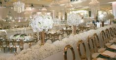 Crystal chandeliers rose gold chairs and tables and all white florals created a romantic and glitzy wedding (Venue: @beverlywilshire | Planner: @internationaleventco | Florist: @kevinleeproductions @shishishikevinlee | Photographer: @john_solano_photography | Videographer: @vidicamproductions | Lighting: @images_lighting | Band: @liventgroup  Rouge | Décor/Rentals: @palacepartyrental | Photo Booth: @mvsstudio | Cake: @jandlcakes | Dresser: @asitbridal | Fruit Station: #Hasmik | Make Up…