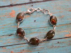 Labradorite bracelet simple modern large by BonfireVintage on Etsy, $34.80 Gemstone Jewelry, Unique Jewelry, Labradorite, I Shop, Beaded Bracelets, Etsy Shop, Trending Outfits, Simple, Handmade Gifts