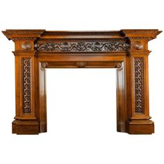 For Sale on - An enormous and grand antique walnut chimneypiece in the neoclassical style. The frieze elaborately carved with three pairs of sea serpents alternating Fireplace Design, Fireplace Mantels, Fireplaces, Altar, Wood Valance, Wood Arch, Closet Lighting, Fireplace Remodel, Neoclassical
