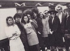 The Cure members & spouses