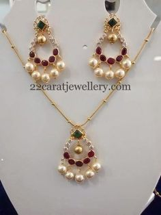 22 carat gold simple fancy necklace with chandbali pendant. Studded with CZ, ruby and emerald stones studded in the center. It carries su...