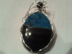 Black and Blue Agate Wire Wrapped in Sterling silver with and onyx bead by MamaGotRocksJewelry on Etsy
