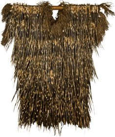 Africa | Cameroon Porcupine Dance Tunic. Kaka people, Grasslands | 20th century | Porcupine quilles, raffia  Woven with applied quills and knotted fiber fringe | completely covered in porcupine quills, front and back. The quills are attached to a woven fibre base. These tunics worn to dance either by hunters or warriors preparing to go forth.