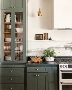 Yay or Nay: Moody Green Interiors – Green cabinets and brass hardware with soapstone counters. – - Yay or Nay: Moody Green Interiors - Green cabinets and brass hardware with soap. Updated Kitchen, New Kitchen, Kitchen Dining, Eclectic Kitchen, Open Shelf Kitchen, Tudor Kitchen, Dining Nook, Awesome Kitchen, Kitchen Furniture
