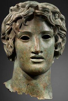Bronze head of Apollo. Hellenistic, 2nd century CE