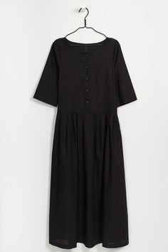 Relaxed fit, round neck dress with button front, pleated skirt & mid length sleeves. Side in-seam pockets. Made from premium 100% certified fair trade organic cotton voile. Italian made recycled hemp buttons.      Chest Waist Front Length from Shoulder Sleeve Length     XS 92cm 90cm 131.5cm 37.5cm   S 97cm 95cm 133cm 38cm   M 102cm 100cm 134.5cm 38.5cm   L 107cm 105cm 136cm 39cm   XL 112cm 110cm 137.5cm 39.5cm    Model is 180cm/5'11