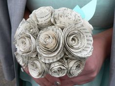 Flower bouquet from old book pages - I was out and about this weekend and saw a bridal party with these amazing bouquets. I had to ask them if I could take a picture as they were awesome! The bride made them all herself. I found a how to link online and have attached the website here in case you want it to. They look so easy to do too!
