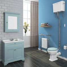 Our exclusive Downton Abbey range features stunning traditional bathroom furniture, such as this fetching duck egg blue vanity unit.