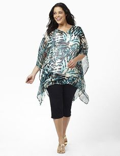 An exotic print covers the sheer fabric of this lightweight poncho. Layer it over your favorite tanks for a fresh update to your outfit. Features a V-neckline and draping sleeves. Catherines accessories are customized in size and scale for the plus size woman. catherines.com