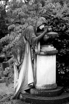 "Statue in cemetery of Tubengin, Germany...photo ""Alone"" by Pierre the III"