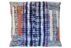 Feeling the boho-chic vibes from this calico striped pillow!