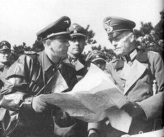 Kurt Meyer (rain coat) and Feldmarschall Rundstedt visiting Hitlerjugend training ground