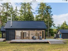 Designed by Prentiss Balance Wickline Architects, this modern cabin offers views of the Olympic Mountains, on the Hood Canal, Washington. Village Houses, Village House Design, Cob Houses, House And Home Magazine, Architect Design, Modern House Design, Home Fashion, Cabana, Modern Architecture