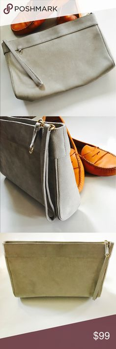 ST. JOHN  gray suede clutch purse Stunningly beautiful light gray/dove gray suede clutch/purse by famous designer St. John. In very good condition I've carried this very minimally. Truly beautiful and chic St. John Bags Clutches & Wristlets
