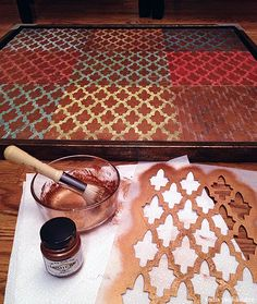 DIY: Scrapbook paper art and stencil with bronze metallic paint. Easy project to make cool wall art!