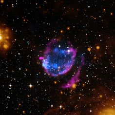 Supernova remnants are created when a massive star explodes and its remains are hurled into space. Astronomers have found a supernova remnant that it is sweeping up a remarkable amount of material—equivalent to 45 times the mass of the Sun—as it expands. This supernova remnant is called G352.7-0.1 and is seen in this composite image containing X-rays from Chandra (blue), radio waves from the VLA (pink), infrared data from Spitzer (orange), and optical data from the DSS (white).