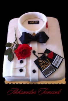 My name is Bond... James Bond's shirt cake... ;-D - This is my secon one shirt cake. One of my clients ask me to do this cake for her fiance. Everything (except tape and flower wire): rose leaves and petals, collar, papillione, bottons, labels are made with home made fondant. On label inside the collar I wrote my initials and inside barcode I codified years of celebrated and his date of birth. New thing is a kiss stencil on the collar.