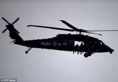 A Mexican Police helicopter overflies the Corona Stadium, in Torreon, Coahuila state, before the start of the Brazil 2014 FIFA World Cup CONCACAF qualifier match between Mexico and El Salvador, on October 16, 2012.