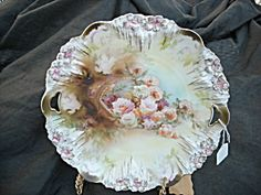 R.S. Prussia Cake Plate Basket overflowing with roses