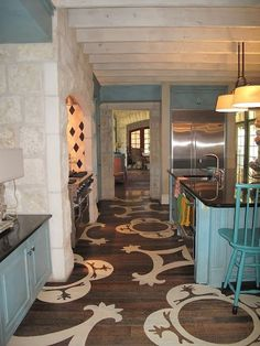 I like the look of natural wood flooring and having the stencil be a pop of color like teal or yellow