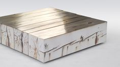 Giant reclaimed wood blocks have been coated in pure silver; the result is visible wood grain with a metallic sheen and a few intriguing spots of oxidation. A clear coat finish prevents further oxidation. The design firm Council's Periodic Table is equal parts occasional table and material experiment, the Periodic Table is a striking piece that juxtaposes a natural material and a bespoke industrial process. It's a magical intersection between industry and nature.