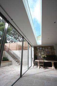 Love the flow of the floor from house into garden. Minimal Windows along a rear extension with walk-on rooflight to the balcony above. Roof Skylight, Roof Window, Skylights, Skylight Blinds, Ceiling Windows, Glass Extension, Roof Extension, Architecture Details, Interior Architecture