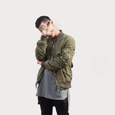 Olive bomber jacket and an attitude
