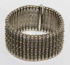 Lot 231: Konstantino Sterling Silver and 18k Gold Bracelet; Wide bracelet having small gold ball adornments; marked inside bracelet