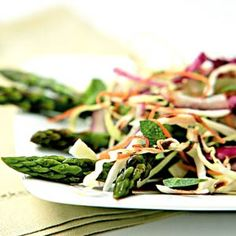 A fresh vegetable slaw tops asparagus in this simple low calorie side dish.
