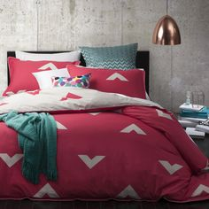 Vespa Coral by Logan & Mason. Available in single, double, queen and king quilt set.
