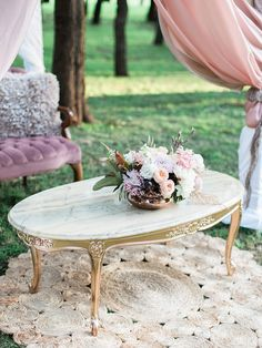 Gold coffee table and pastel florals | We Are Origami | See more: http://theweddingplaybook.com/pastel-bohemian-wedding-inspiration/
