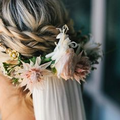 It's easy to fall in love with a romantic bridal look and this one is gold. Our favorite detail: The silk veil coming out of the flowers.