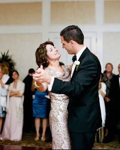 "This mother of the groom's shimmery brocade sleeveless dress with a draped neckline suited every part of this Pebble Beach fête, including the mother-son dance to Josh Groban's ""You Raise Me Up."""